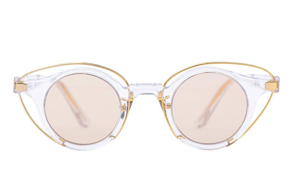 Gafas de diseño con tonos dorados